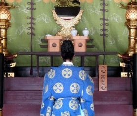 Priest in deep prayer on Dazaifu Tenmagu Shrine in Fukuoka, Japan, 2007